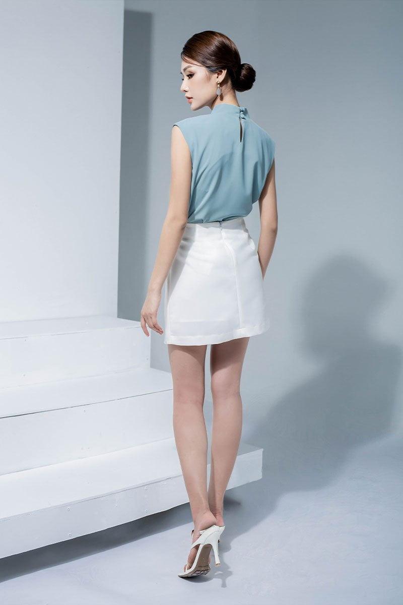 Chân váy A can chéo vạt trước trắng